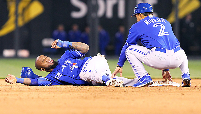 Toronto's Jose Reyes could be out until the All-Star break after spraining his ankle on a hard slide.