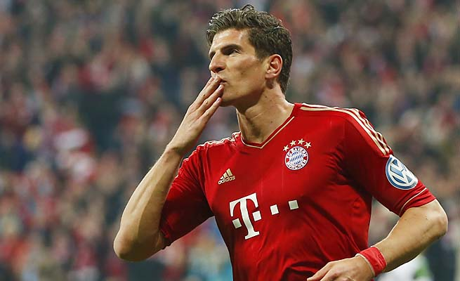 Mario Gomez and Bayern are trying to win the treble -- league, cup and Champions League.