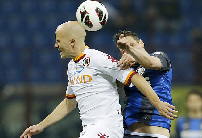 AS Roma's Michael Bradley jumps for a header with Inter Milan's Zdravko Kuzmanovic.