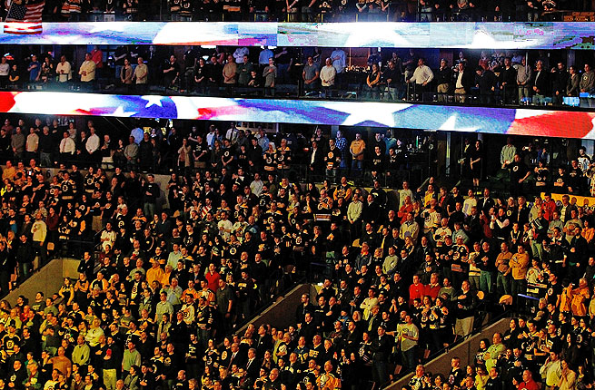 Boston fans observed a moment of silence, then sang the national anthem in a powerful moment.
