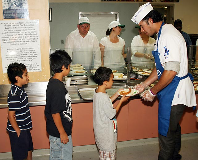 Dodgers right fielder Andre Ethier hands out food at the Union Rescue Mission in downtown Los Angeles.