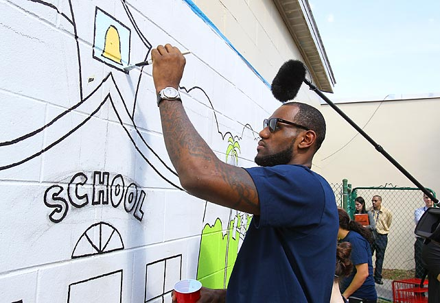 """LeBron James paints at the Coalition for the Homeless as part of NBA Cares' """"Learn"""" 2012 Day of Service."""