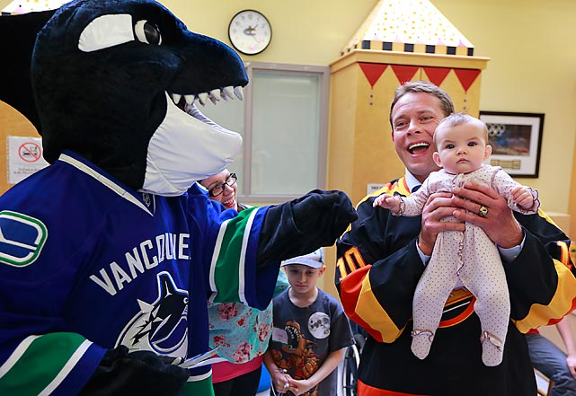 Canucks mascot Fin accompanies former player Pavel Bure on a visit to Vancouver's Children Hospital.
