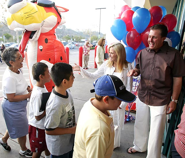 Phil and Amy Mickelson donated $200,000 to help needy kids get a back-to-school shopping spree, and greeted some of the more than 1,000 kids here at a San Diego Wal-Mart.