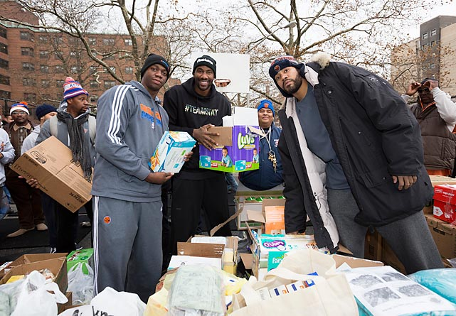 Knicks players (from left) Rasheed Wallace, Ronnie Brewer (who is now with the Thunder) and Amar'e Stoudemire visit a relief operation for Hurricane Sandy at the Edgemere Housing Projects in New York.