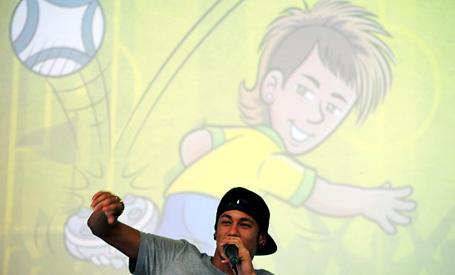 "Neymar answers questions during the presentation of ""Neymar Jr,"" a Brazilian comic based on him."