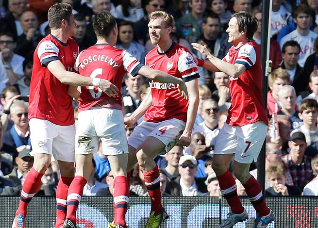 Per Mertesacker (second from right) scored the only goal in Arsenal's away win over Fulham.