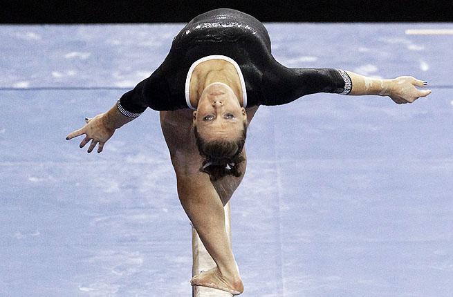 Bridget Sloan of Florida competes on the balance beam in the NCAA women's gymnastics championship.