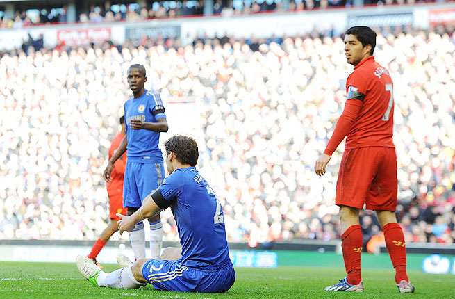 Chelsea's Branislav Ivanovic (left) inspects his arm after being bitten by Liverpool's Luis Suarez (right).
