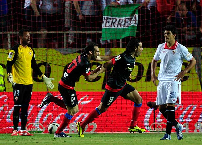 Radamel Falcao (center right) again proved his worth by netting the lone goal in Atletico's win over Sevilla.