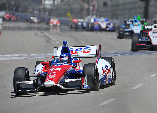 Takuma Sato overcame a late challenge from Graham Rahal to take the checkered flag at Long Beach.