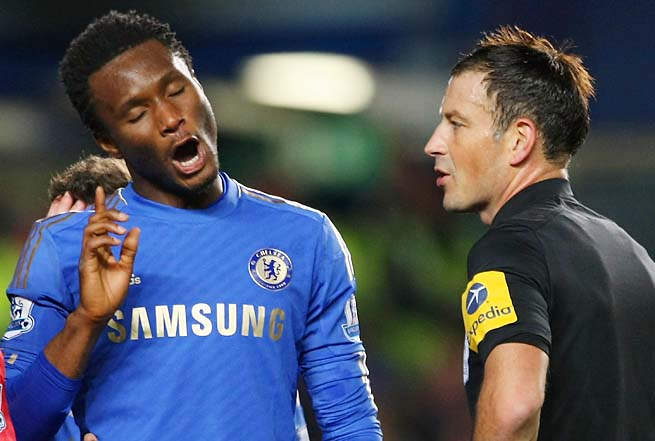 Mark Clattenburg (right) was accused of racially abusing John Obi Mikel in October.