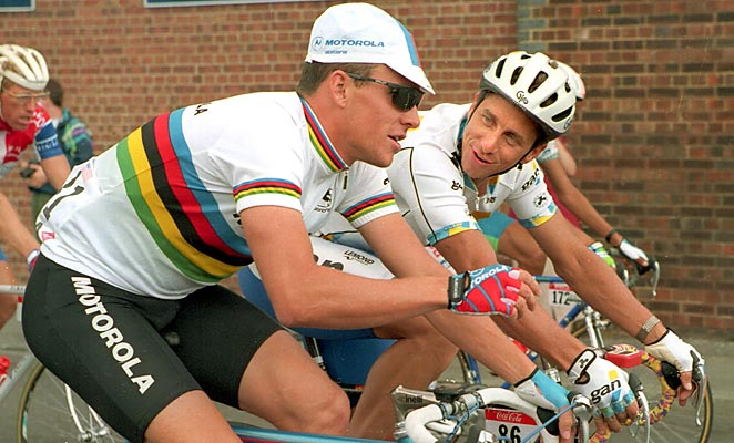 In this file photo, Greg LeMond, right, talks to Lance Armstrong during the 1994 Tour de France.