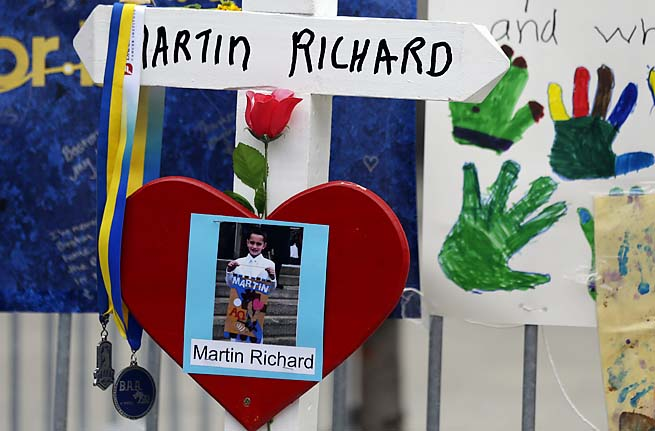 A photo of Martin Richard, 8, hangs at a memorial near the finish line of the Boston Marathon.