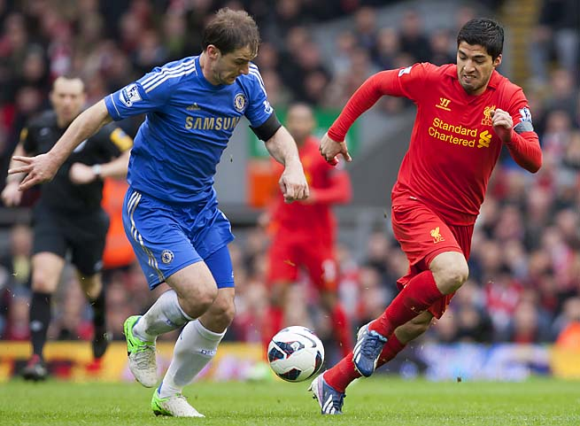 Luis Suarez (right) defends Branislav Ivanovic during the match in which he bit the Chelsea player.