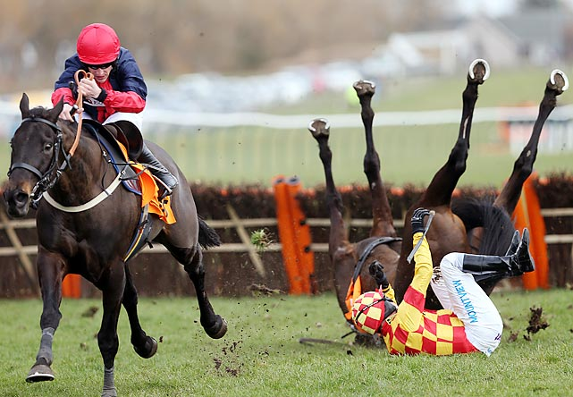 Ifandbutwhynot takes a spill, as does rider Timmy Murphy, during the QTS Scottish Champion Hurdle Race Saturday in Ayr, Scotland.