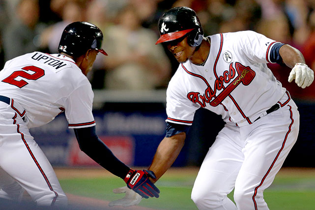 The power-hitting siblings -- who are on the same major league team for the first time in their careers -- hit back-to-back homers for Atlanta in a 10-2 win against the Rockies on April 23, 2013. It was the 27th time in major league history that brothers homered in the same game, but only the second time they went deep in consecutive at-bats. (Lloyd and Paul Waner of the Pittsburgh Pirates also accomplished the feat on Sept. 15, 1938).