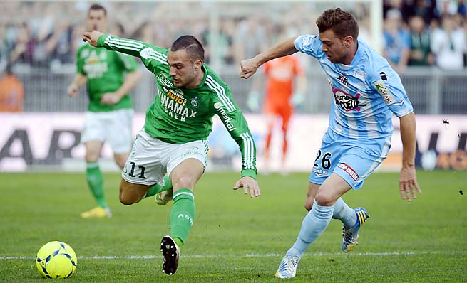 Saint-Etienne midfielder Yohan Mollo (left) vies with Ajaccio defender Samuel Bouhours.