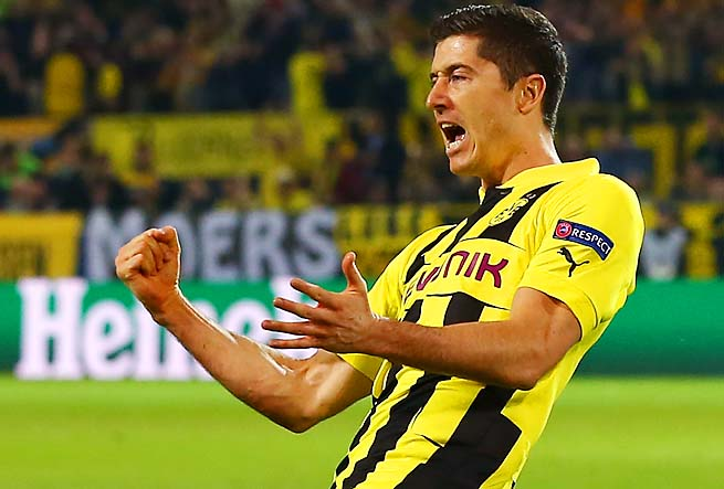 Robert Lewandowski celebrates his first of four goals in the eighth minute for Dortmund.