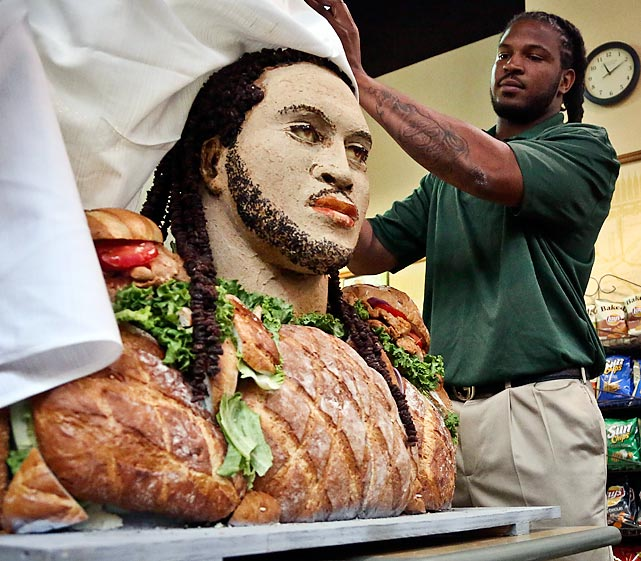 Georgia's top 2013 NFL draft prospect unveils a head cheese (that looks suspiciously just like him) and BBQ Chicken Smokehouse extravaganza at a Subway in New York. Among the other athletic luminaries who have been served are Robert Griffin III, Justin Tuck, Michael Strahan, Ndamukong Suh, Blake Griffin and Michael Phelps.