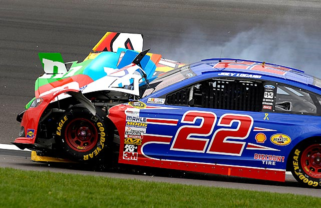 Kyle Busch's No. 88 Studebaker Speedster looks festive in an almost floral way after a little pow-wow with Joey Logano's No. 22 Dusenberg during the STP 400 at Kansas Speedway.