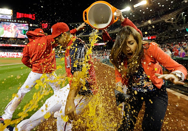 Pitcher Gio Gonzalez and MASN sideline reporter Julie Alexandria enjoy a little Gatorade courtesy of an unidentified hurler after an exciting game won 8-1 by the home team at Nationals Park in Washington.