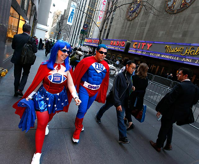 The big event at New York City's famed Radio City Music Hall attracted the curious and the kooky, such as these New York Giants fans who are modeling the team's new redesigned uniforms for the 2013 season. The Jacksonville Jaguars have also unveiled a new look.