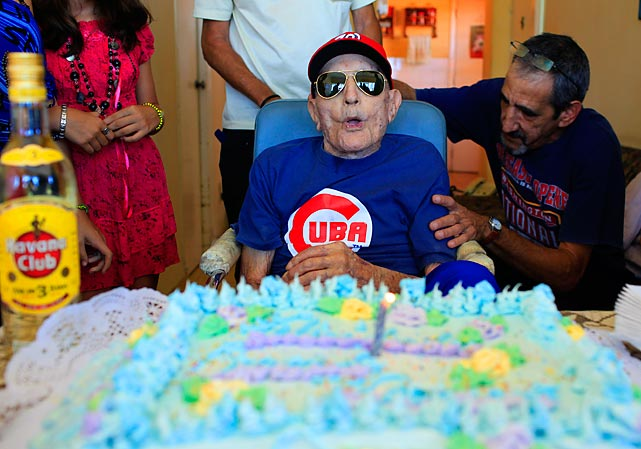 At 102, the world's oldest living big league player is livin' large in Havana with the $20,000 he finally got from Major League Baseball as a grant to old-timers (and if this guy don't qualify, then no one does) who played between 1947 and 1979. The dough (not the stuff in the cake) was held up for three years by the U.S. embargo on Cuba, but Senor Marrero refused to leave without it.