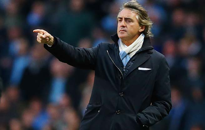 """We moved so slow (last year),"" Manchester City manager Roberto Mancini said."