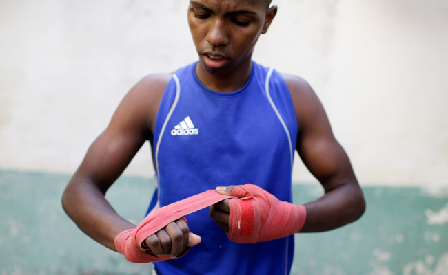 Boxer Osain Gonzalez prepares to fight in a local boxing tournament in Old Havana, Cuba.