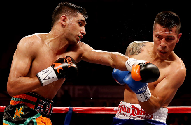 Amir Khan (left) beat Mexico's Julio Diaz in a unanimous 12-round decision in a welterweight bout.