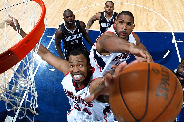 The Hawks' Jason Collins and Al Horford battle for a rebound against Brandon Bass of the Magic during Game 6 of the Eastern Conference first round in 2011.