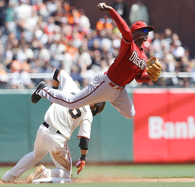 Arizona Diamondbacks shortstop Did Gregorius makes an athletic throw to first after forcing the Giants' Brandon Crawford out at second during a 3-2 win in 10 innings on April 24.