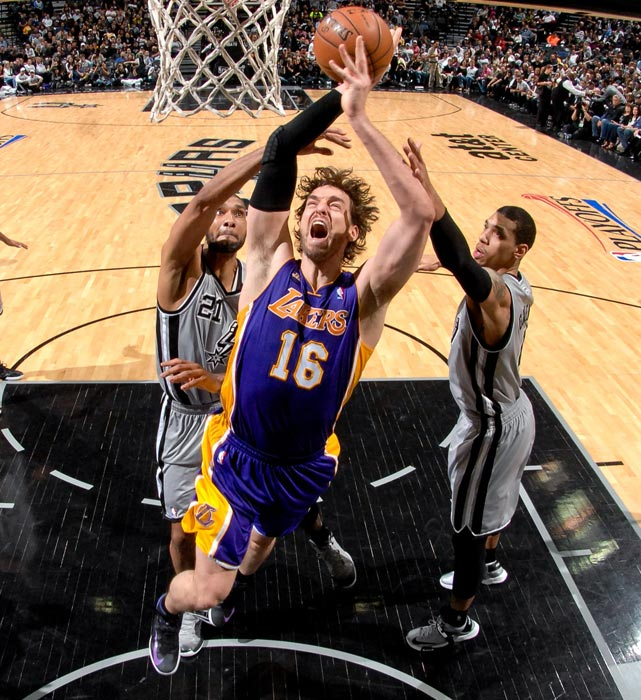 Lakers forward Pau Gasol powers his way to the basket against Tim Duncan during the a 102-91 loss in Game 2 of the Western Conference quarterfinals on April 24.