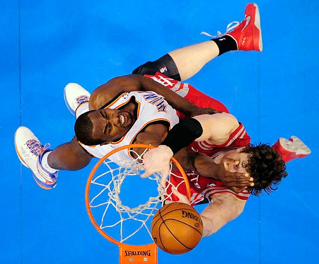 Omer Asik of the Houston Rockets tangles with the Thunder's Serge Ibaka in his team's 105-102 Game 2 loss on April 24.
