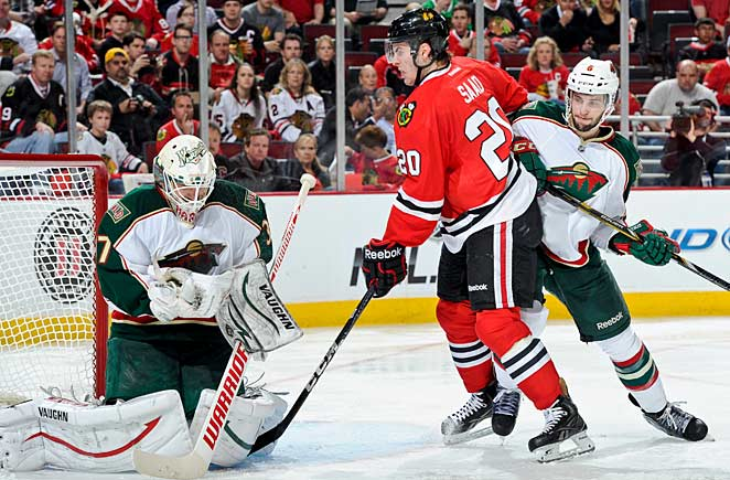 Brandon Saad and the Blackhawks struggled, but finally beat heroic Wild goalie Josh Harding.