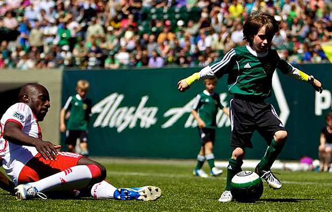 Eight-year-old Atticus Lane-Dupre (right) scored twice in a scrimmage against the Portland Timbers.