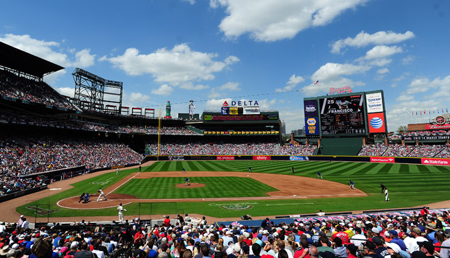 An Atlanta-based TV employee died of a heart attack at Wednesday's Nationals-Braves game.