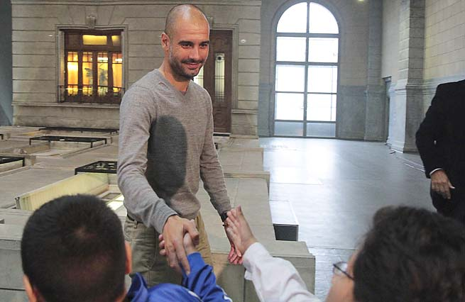 Pep Guardiola greets school children in Buenos Aires, Argentina, on Thursday.