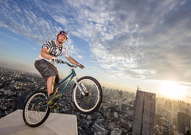 Red Bull's bike safety campaign message. Always remember to wear a helmet when riding on a 64th story ledge, kids. And be sure to tell your parents what you've gotten up to.