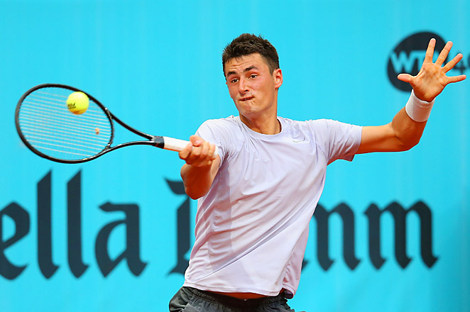 Bernard Tomic's father and coach, John Tomic, was reported as being arrested for assaulting Thomas Drouet.
