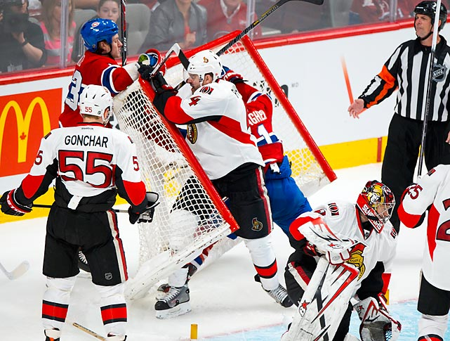 A fiercely physical game between the Ottawa Senators and the Montreal Canadiens not only saw a bloodied Lars Eller rushed off the ice, but also this hit from the Senators' Chris Phillips on Brendan Gallagher that took the net off.