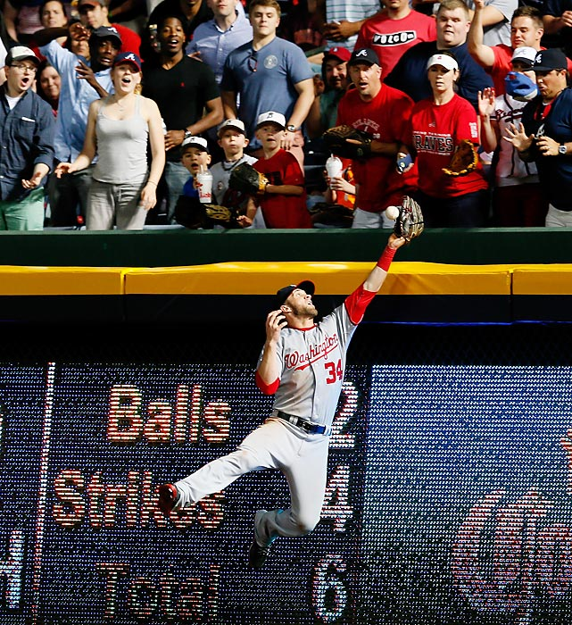 Bryce Harper's reach wasn't quite enough to stop a solo home run from the Atlanta Braves' Tim Hudson as Atlanta ran away with an 8-1 victory over the Washington Nationals on May 1.
