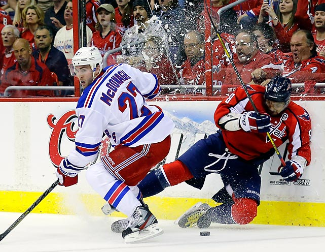 Rangers defenseman Ryan McDonagh (27) leaves Capitals left wing Alex Ovechkin on the wall, taking the puck from him in New York's 3-1 loss to open the teams' conference quarterfinal series.