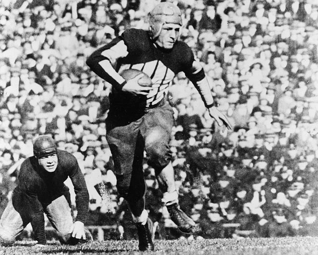 "Legendary sportswriter Damon Runyon once said Grange was a combination of other athletes: ""He is Jack Dempsey, Babe Ruth, Al Jolson, Paavo Nurmi and Man o' War."" In a 1924 game, Grange ran for 262 yards and four touchdowns...on four plays in 12 minutes. The Galloping Ghost was only 5-foot-11, 175 pounds, but no one at the college level could stop him. Grange was a three-time All-America."