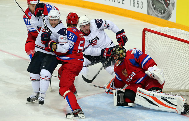 Russian goalie Ilya Bryzgalov (R) makes a save on Justin Faulk (#27) of USA during IIHF World Championship group play.