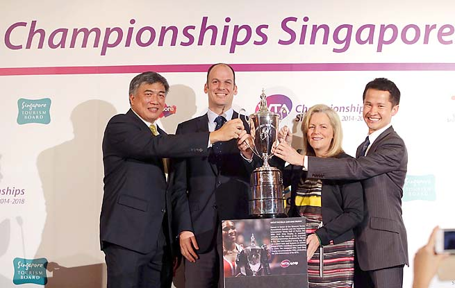 WTA and Singapore executives pose with a masters trophy replica during Wednesday's press conference.