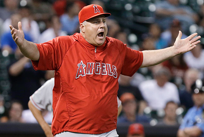 Mike Scioscia couldn't believe what he was seeing when umpires missed an obvious call during the Angels' win in Houston.