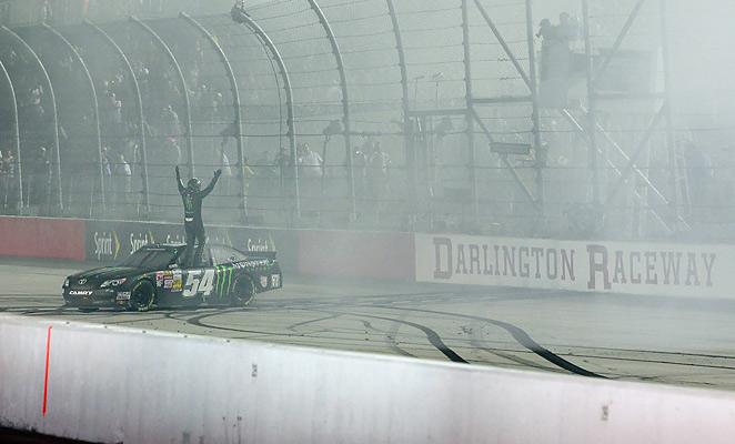 Kyle Busch beat out Joey Logano to get the victory at Darlington Raceway on Friday.