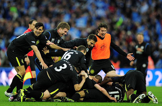 Wigan Athletic players celebrate Ben Watson scoring the match winning goal during the FA Cup final.